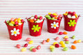 Colorful easter eggs in red buckets candy four Stock Image