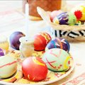 Colorful easter eggs on table egg in the fresh spring meadow Royalty Free Stock Images