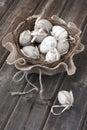 Colorful easter eggs in wicker basket
