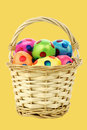Colorful easter eggs in a wicker basket