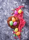 Colorful Easter eggs and wicker bread Royalty Free Stock Photo