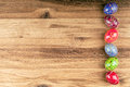 Colorful easter eggs on wooden background horizontal photo Royalty Free Stock Photos