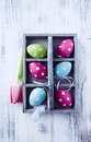 Colorful easter eggs in a wooden box close up of Royalty Free Stock Image
