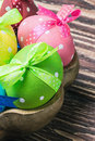 Colorful easter eggs in a wooden plate Royalty Free Stock Image