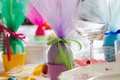 Colorful easter table setting with beautiful crockery eggs ribbons shallow depth of field focus on the green ribbon Stock Photos