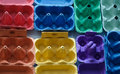Colorful egg containers easter background Royalty Free Stock Image
