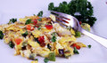 Colorful egg omelet with fork Stock Photo