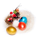 Colorful eggs in a wicker over white background Royalty Free Stock Image