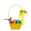 Colorful eggs in a wicker over white background Stock Photography