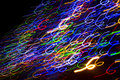 Colorful electric lights in motion over black Stock Images