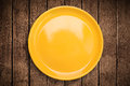 Colorful empty plate on grungy background table Royalty Free Stock Photo