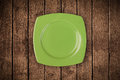 Colorful empty plate on grungy background table shiny Royalty Free Stock Image