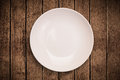 Colorful empty plate on grungy background table shiny Royalty Free Stock Photo