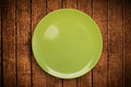 Colorful empty plate on grungy background table shiny Royalty Free Stock Images