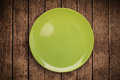 Colorful empty plate on grungy background table shiny Stock Image
