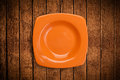 Colorful empty plate on grungy background table shiny Stock Photo