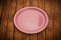 Colorful empty plate on grungy background table shiny Stock Images