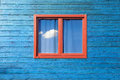 Colorful exterior architecture modern wooden blue facade and red window under blue sky Stock Photos