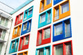Colorful facade of modern apartment building a symbol housing rental anonymity city Royalty Free Stock Photos