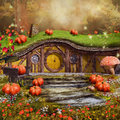 Colorful fairytale cottage with pumpkins mushrooms and flowers Stock Photo