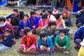 Colorful Families Watch Yak Festival Celebration in Bhutan Village Royalty Free Stock Photo