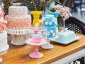 Colorful fancy cake on white cakestand Royalty Free Stock Photo