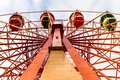 Colorful Ferris wheel in the autumn park. Royalty Free Stock Photo