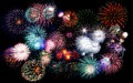 Colorful festive fireworks sparklers salute petards explosions isolated over black night sky background Stock Image