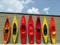 Colorful fiberglass kayaks buchanan va – july on the shop of twin river outfitters in buchanan virginia on july in buchanan Stock Image