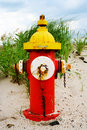 Colorful fire hydrant on the beach Royalty Free Stock Photography