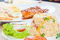 Colorful fired rice on white plate Stock Photography