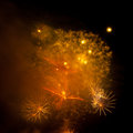 Colorful fireworks on the black sky Stock Images