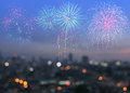 Colorful fireworks on blur city skyline background Royalty Free Stock Photo