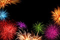 Colorful fireworks with copyspace joyful multi colored as a frame black in the background ideal for new year or other celebration Stock Image
