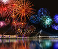 Colorful fireworks near water Royalty Free Stock Image