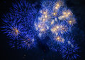 Colorful fireworks over dark sky displayed during a celebration Royalty Free Stock Images