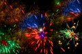 Colorful fireworks over a night sky Royalty Free Stock Photos