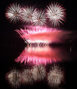 Colorful fireworks with reflection on lake. Royalty Free Stock Photo