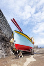 Colorful fisher boat calhau pico azores on the pier at island Stock Images