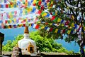 Colorful flags flutter in the wind over the stupa in Kathmandu, Nepal Royalty Free Stock Photo