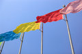 Colorful flags flying under blue sky Stock Image