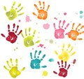 Colorful flat hands imprints with paint blots variously colored and Stock Images