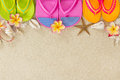 Colorful Flip Flops  with shells and frangipani Royalty Free Stock Image