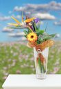 Colorful floral arrangement vase white table meadow flowers background Royalty Free Stock Photos