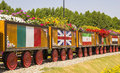 Colorful floral train with flags of different countries in a park in dubai miracle garden Royalty Free Stock Image