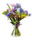 Colorful flower bouquet arrangement centerpiece in vase isolated on white background closeup Royalty Free Stock Photo