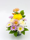 Colorful flower bouquet arrangement in vase isolated on white Royalty Free Stock Photo