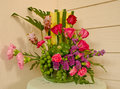 Colorful flower bouquet arrangement in vase on the table Royalty Free Stock Photo