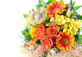 Colorful flowers bouquet with easter eggs roses and gerbera decoration Stock Image