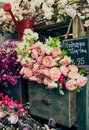 Colorful flowers displayed on green vintage cabinet drawer Stock Photo